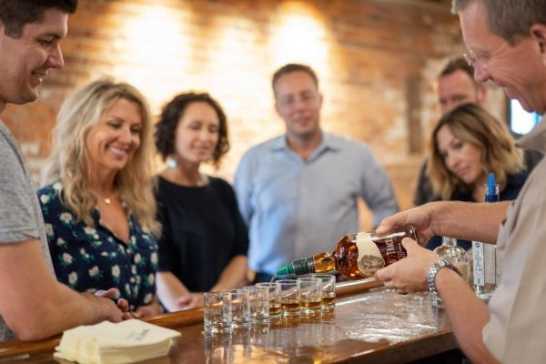 Download Group of people receiving tasting of Buffalo Trace
