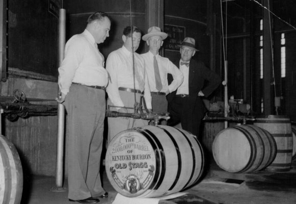 Download Group of men recognizing 2,000,000th barrel