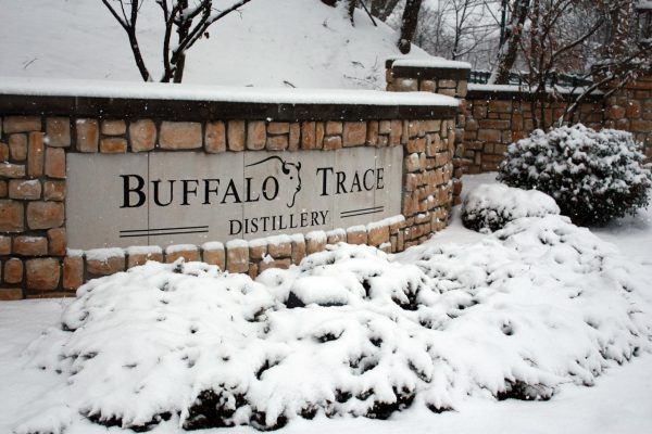Download Stone wall snow-covered entrance to Buffalo Trace Distillery